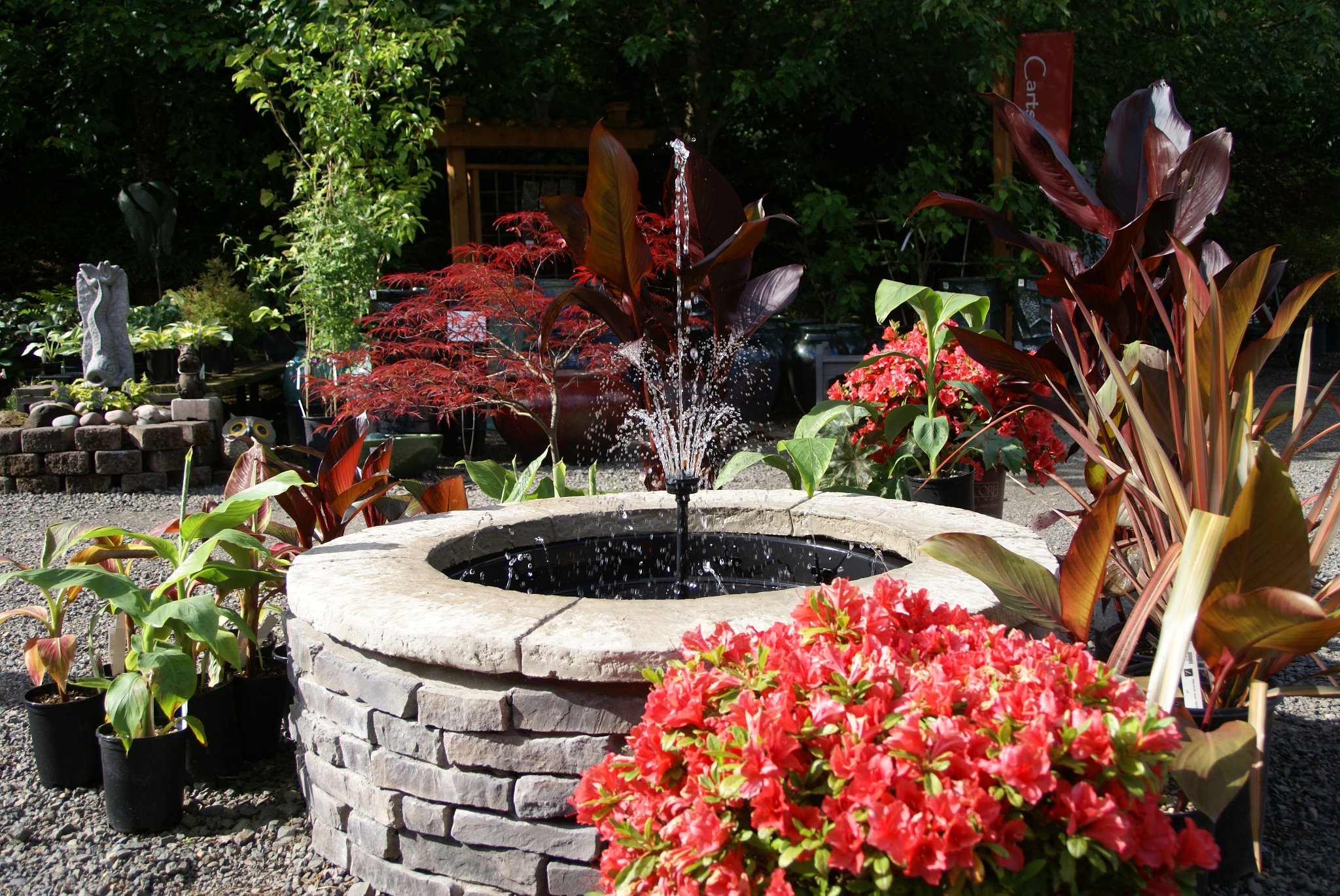 Fire pit doubles as musical water fountain garden center tv for Flower fire pit